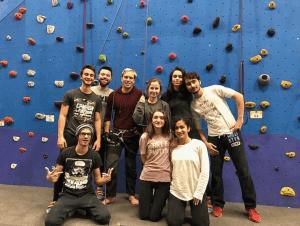 mentora college students rock climbing